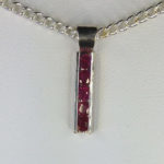 castle-rocks-and-jewelry-rubies-set-in-track-pendant-robert-michael